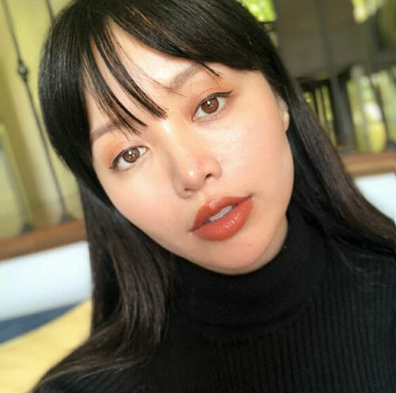 image of Michelle Phan with no foundation on