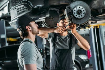 two men working in an auto repair shop